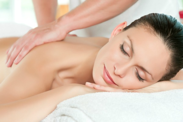 Woman relaxing with hand massage at spa